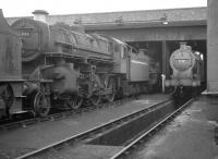 43006 and 44439 are amongst the locomotives on 12D Workington shed in September 1962. Closed to steam in 1968 the 12-road shed was later used as a diesel depot (WK) and finally as a wagon repair shop, before being abandoned in 1995. In 2006 the old shed was purchased by the Great Central Railway, Loughborough, to where it was later moved in sections.<br><br>[K A Gray&nbsp;22/09/1962]