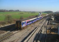 A Blackpool North to Manchester service formed by Northern 156423 heads east passed Salwick SB on 12 February 2008.<br> <br><br>[John McIntyre&nbsp;12/02/2008]