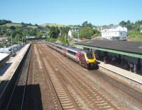 A Penzance to Edinburgh service, formed by a Cross Country Super Voyager, calls at Totnes in this view westwards from the station footbridge. There are still two through roads at Totnes, in addition to the two platform lines, allowing overtaking between Plymouth and Newton Abbott and also giving freights a run at the steep banks that lie either side of the station. <br><br>[Mark Bartlett&nbsp;17/06/2010]