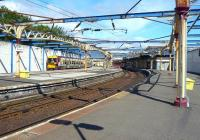 Sunshine on Gourock. With work now underway on the new station, scenes like this will soon become a memory. The 11.23 Gourock - Glasgow Central service bides its time at platform 3 on 29 July 2010. [See image 30014]  <br><br>[Colin Miller&nbsp;29/07/2010]