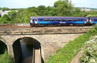 A westbound train on the Edinburgh - Glasgow Central via Shotts route is about to cross the Water of Leith on Slateford Viaduct in June 2010.<br><br>[John Furnevel&nbsp;/06/2010]