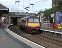320 315 stands at the eastbound platform at Coatbridge Sunnyside with an Airdrie service.  In a few short months lucky Coatbridgers will be able to catch a regular service from that platform to Edinburgh (should that be their wish).<br><br>[David Panton&nbsp;14/08/2010]