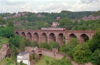 A local service crosses the Pulverm�hle Viaduct, just to the north east of Luxembourg station, in 1991. View looks east. This viaduct is to be duplicated by a second viaduct due to projected increased traffic from the Kirchberg and Oetrange lines.<br><br>[Ewan Crawford&nbsp;25/07/1991]
