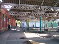 Inside the 1882 NER station at Tynemouth in August 2010 looking from the main concourse over the abandoned excursion platforms towards Newcastle. While there appears to have been little change with regard to the poor state of some of the canopies in the past 28 years [see image 20686], happily, funding is now in place for the COMPLETE restoration of the roof.<br> <br><br>[Colin Alexander&nbsp;18/08/2010]