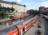 The start of the Hamburg evening rush hour on 27 July 2010. On the left of the photograph two local services are departing the station almost in unison, while in the centre a double decker service for Lubeck awaits its departure time, as does an ICE train on the right.<br><br>[John Steven&nbsp;27/07/2010]