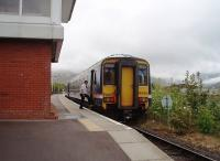 First train of the day, from Mallaig to Glasgow, on a misty overcast morning, calls at Banavie and is seen alongside the signalling centre. The guard rejoins 156456 before the train moves off for the next stop (and reversal) at Fort William. <br><br>[Mark Bartlett&nbsp;19/05/2010]
