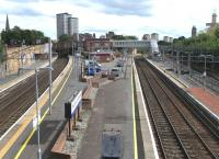 Looking south over Motherwell station on 14 August 2010.� Main line <br> platforms are on the left, with Hamilton Circle platforms 3 and 4 and then stabling at the far right.� Platform 3 is considerably longer than Platform 4, but having no main line services is rather unlikely to see its full 12-carriage length filled! <br> <br><br>[David Panton&nbsp;14/08/2010]
