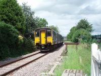The track has been relaid since my last visit to Daisyfield [See image 26413]. 150207 runs onto the single line over the level crossing and through the closed station on its way from Clitheroe to Manchester.<br><br>[Mark Bartlett&nbsp;08/07/2010]