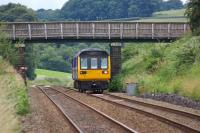 Looking west from Pleasington station on 29 July 2010 as 142055 approaches on a Blackpool South - Colne service.<br><br>[John McIntyre&nbsp;29/07/2010]