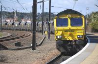 Freightliner 66953 is routed into the platform road at Dunbar on 20 August 2010. The train is the 6Z28 Leith Docks - Drax Power Station imported coal. The diversion is being carried out in order to facilitate a passing movement on the main line.<br><br>[Bill Roberton&nbsp;20/08/2010]