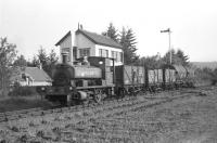 Barclay 0-4-0ST No 1 <i>Dailuaine</i> with three ex-Aberdeen Gas Board coal wagons and two tank wagons alongside Boat of Garten North signal cabin on 15 June 1974.<br> <br><br>[John McIntyre&nbsp;15/06/1974]