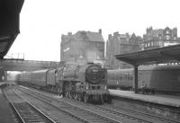 Britannia Pacific no 70054 <I>Dornoch Firth</I> drifts into Carlisle in the summer of 1965 with the 10.35am Glasgow Central - Blackpool North, which has run via Kilmarnock.<br><br>[K A Gray&nbsp;24/07/1965]