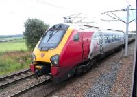 An Edinburgh-bound Virgin Voyager between Carstairs South and East Junctions on 28 August 2010.  Photograped from a Glasgow Central - North Berwick Class 322, halted at signals east of Carstairs station to let it pass.<br><br>[David Panton&nbsp;28/08/2010]