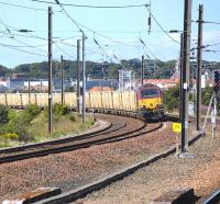 67021 leans into the curve at Dunbar as it nears its destination with the 6B45 Powderhall - Oxwellmains <i>Binliner</i> on 20 August 2010.<br><br>[Bill Roberton&nbsp;20/08/2010]