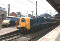 Past and present traction on the East Coast Main Line standing together at Newcastle on 30 August 2010. On the left, recently arrived from Edinburgh, is 91131 en route to London, while on the right is Deltic no 55022 <I>Royal Scots Grey</I>, which had arrived earlier with the Compass Tours <I>Western and Eastern Coastal Express</I> from Crewe.<br> <br><br>[John McIntyre&nbsp;30/08/2010]