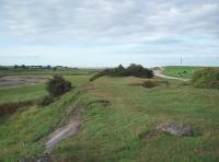 A branch of the Carnforth Ironworks tramroad was used for tipping slag alongside the Keer estuary. The old slag heaps have now been incorporated into a local landfill site but parts of them are still visible as is this section of the old formation looking south alongside the River Keer estuary towards the sea. Map Reference SD 486714<br><br>[Mark Bartlett&nbsp;27/08/2010]