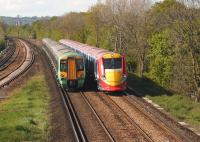 A Southern class 377 passing a down class 460 <I>Gatwick Express</I> service near Salfords in May 2005.<br><br>[Ian Dinmore&nbsp;/05/2005]