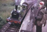 Early days on the KWVR as J72 0-6-0T 69023 <I>Joem</I> gets ready for departure with a service for the branch terminus at Oxenhope. 69023 has recently been restored to full working order and is in the care of the North Eastern Locomotive Preservation Group. <br><br>[Mark Bartlett&nbsp;/05/1969]
