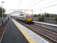 Paisley St James has recently reopened after a two-and-a-half month <br> closure for refurbishment.� 334 002 stands with a Gourock to Glasgow <br> stopping service on 1 September as a semi-fast, which didn't stop, <br> retreats.�[See image 20078 for a comparison.] <br> <br><br>[David Panton&nbsp;01/09/2010]