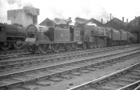 Scene in the yard at Kingmoor on 1 August 1959, with McIntosh ex-Caledonian 0-4-4T no 55234 and BR Standard class 9F 2-10-0 no 92152 amongst the locomotives on shed.<br><br>[Robin Barbour Collection (Courtesy Bruce McCartney)&nbsp;01/08/1959]