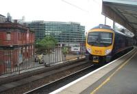 The through westbound platform at Manchester Piccadilly sees TPE 185144 calling on a Liverpool service. Across the road the closed Manchester Mayfield terminus building can be seen. [See image 30083]<br><br>[Mark Bartlett&nbsp;09/07/2010]