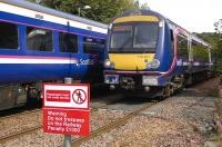 First Scotrail 158 and 170 services pass at Aberdour on 31 August 2010.<br> <br><br>[Bill Roberton&nbsp;31/08/2010]