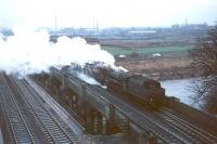 A Black Five with a freight northbound from Carlisle in the sixties. The train is crossing the 1942 bridge built to carry the goods lines over the River Eden at Etterby.<br><br>[Bruce McCartney&nbsp;//]