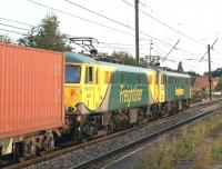 A southbound Freightliner container train with 86627 + 86637 passing <br> through Leyland station on 3 September 2010. An interesting contrast between the old and new Freightliner liveries.<br> <br><br>[John McIntyre&nbsp;03/09/2010]