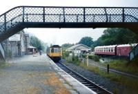 A rainy day at Betws-y-Coed in July 1991 as a dmu departs from the solitary remaining platform bound for Llandudno. To the right is the Railway Museum.<br> <br><br>[Colin Miller&nbsp;/07/1981]