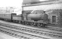 Class J35 0-6-0 no 64509 stands alongside Hawick shed in the summer of 1958. The old coach behind the locomotive is thought to have been the shed's tool van. <br><br>[Robin Barbour Collection (Courtesy Bruce McCartney)&nbsp;22/07/1958]