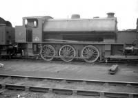 WD165 photographed in the yard at Kingmoor  on 1 August 1959. The ex-WD 0-6-0ST (AB 2183 of 1943) was on its way north to Steeles of Hamilton, from where it was eventually acquired by the Wemyss Private Railway and renumbered 15 [see image 6246]. Several years later, following a spell in Muir's yard in Thornton, the locomotive was purchased for preservation. It is currently undergoing a scheduled overhaul on the East Lancashire Railway, where it carries the name <I>Earl David</I>.<br><br>[Robin Barbour Collection (Courtesy Bruce McCartney)&nbsp;01/08/1959]