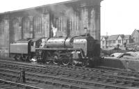 Britannia Pacific no 70039 <I>Sir Christopher Wren</I> stands alongside the west wall at the north end of Carlisle station in August 1964. One of several of the class to spend its final operational days at Carlisle, no 70039 was eventually withdrawn from Kingmoor shed in September 1967 and said its final goodbyes from the yard of Messrs McWilliams at Shettleston in January 1968.<br><br>[K A Gray&nbsp;01/08/1964]