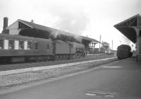 60073 <i>St Gatien</I> is too fast for the camera shutter at Tweedmouth on 12 August 1960 as the A3 runs through the station with the up <I>Queen of Scots</I> Pullman.<br><br>[Robin Barbour Collection (Courtesy Bruce McCartney)&nbsp;12/08/1960]