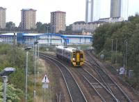 Against a backdrop of the high flats of Springburn 158 741 descends <br> the Cowlairs incline on the last mile and a half to Queen Street on 11 September 2010.� Going off to the right is the cord, opened in 1993, which finally allowed through running from Queen Street to Buchanan Street's old line, 27 years after Buchanan Street closed.� Such were the consequences of Victorian competition in this part of the network.�Though only 17 years old Cowlairs South Junction has already been renamed: it was initially called Pinkston Junction.<BR/><BR/>[<I>Editor's note: The photograph serves as a reminder that this month marks the 20th anniversary of the introduction of the Class 158s, when, following a protracted testing period, 158701 was launched into service during a photocall at Blair Atholl station in September 1990</I>]<br> <br><br>[David Panton&nbsp;11/09/2010]