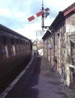 The 4.51pm train to Dumfries taking water at Kirkcudbright terminus just two weeks before the end of passenger services on the branch. Closure came on 3rd May 1965.<br><br>[Frank Spaven Collection (Courtesy David Spaven)&nbsp;/04/1965]