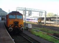 <I>Thunderbird</I> 57304 sits in the shaded bay at the north end of Platform 3 while 158791 leaves Platform 6 bathed in sunlight and heads for Blackpool North. <br><br>[Mark Bartlett&nbsp;08/09/2010]