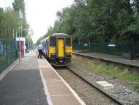 After picking up passengers at Burscough Junction station on 6 September 2010, unit 153315 gets ready to continue on its journey from Ormskirk to Preston. On the disused platform on the right (the former Liverpool platform) work has been progressing following the tidy up and the construction of a number of raised beds by the Friends of Burscough stations voluntary group.<br> <br><br>[John McIntyre 06/09/2010]