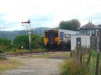 From the trackbed of the old Furness Railway line to Sandside and Hincaster, a Cumbrian Coast service is seen as it leaves the Kent Viaduct and rolls in to Arnside station. 156490 is just passing the old Furness Railway signalbox and the hills behind are on the far side of Kent Estuary.  <br><br>[Mark Bartlett&nbsp;11/09/2010]