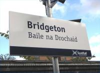 Scotrail's programme of Gaelic education by station nameboard rolls <br> on.�I assume there's no serious suggestion here that Bridgeton was ever known as Baile na Drochaid.� This would be transliterated as <br> Balnadrochit and means 'town of the bridge'.� The settlement was far <br> more likely established when the area was English/Scots speaking, but there are plenty of real Gaelic-based names around such as the next two stations along the line: Dalmarnock and Rutherglen.� <br><br>[David Panton&nbsp;11/09/2010]