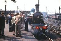 <I>'Now then, now then, no kissing the locomotive please...'</I>  A couple of steam fans seem to be getting a bit too <I>'up close and personal'</I> at Buchanan Street on 10 May 1958 as CR 123 waits to take out a special.<br><br>[A Snapper (Courtesy Bruce McCartney)&nbsp;10/05/1958]