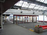There is a three-platform terminus on either side of the Firth of <br> Clyde, but the contrast between Helensburgh Central and Gourock is <br> marked.� The former is smartly turned out with a lively air, whereas <br> Gourock, although it sees more trains, is - well see for yourself in this photograph taken from the concourse on 1 September 2010. There is no glazing in the platform canopies, and the building is unoccupied with the ticket office etc in Portakabins (TM) outside.� Happily though an impressive new permanent ticket office nears completion and the platform area is due for a makeover in 2011.� <br> <br><br>[David Panton&nbsp;01/09/2010]