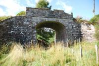 Still standing fifty years after the closure of the Fortrose Branch, a farm access bridge crumbling away in the corner of a field�west of�Munlochy in September 2010.<br><br>[John Gray&nbsp;15/09/2010]