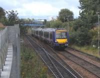 170 416 nears the end of its climb to Cowlairs with the 0915 to <br> Edinburgh on 11 September.  It is crossing the points at Cowlairs South, the junction for the cord to Sighthill West Junction used by services via Cumbernauld.  Like other EGML junctions it had lighting installed last year.  Railways had managed 180 years without 'street' lighting: let's see if it catches on.<br><br>[David Panton&nbsp;11/09/2010]