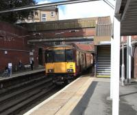 On 11 September, unit 318 266 emerges from Canning Street tunnel into Bridgeton station with a Lanark direct service.� Meanwhile, with a train at the opposite platform imminent, all passengers (except possibly the infant) are frantically phoning and texting before they lose the signal for several vital minutes.<br> <br><br>[David Panton&nbsp;11/09/2010]