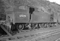 Reid C16 4-4-2T no 67489 stands in a siding at Hawick on 2 February 1958. It is recorded as being officially withdrawn in February 1961 and cut up at Cowlairs works the following month. The locomotive does not seem to have been put to much (any?) use  during its stay at Hawick where it had arrived from Dundee Tay Bridge in late 1955. [With thanks to Ross Turnbull] [See image 9175].<br><br>[Robin Barbour Collection (Courtesy Bruce McCartney)&nbsp;/02/1958]
