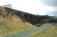 View west at Cargenbrdge Viaduct towards Castle Douglas on 16 March 2010. The viaduct marks the end of the 'Maxwelltown Railway Path', a tarmac surfaced cycling and walking route from Dumfries which now runs along the old trackbed. [See image 25379] Part of the former Cargenbridge ICI Works can be seen on the right. [The viaduct itself is currently fenced off having been officially declared an 'unsafe structure'.]<br><br>[Ken Strachan&nbsp;16/03/2010]
