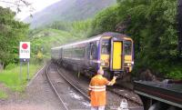 The 10.10 ex- Mallaig runs into Glenfinnan to cross 45231 on <I>The Jacobite</I> on 27 June 2010.<br><br>[Colin Miller&nbsp;27/06/2010]