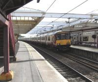 A Glasgow service pulls into Troon on a sunny weekday afternoon on 1 <br> September.� The Class 318 set looks as though it might be stretching all the way back to Ayr, though it is only in fact 6 coaches long (count 'em).<br> <br><br>[David Panton&nbsp;01/09/2010]