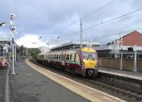 334 032 stands at Partick on 11 September with a Dalmuir to <br> Springburn service.� Off-peak the hourly pattern this way is 2 <br> Springburns, 4 Airdries, 2 High Streets, 2 Larkhalls, 2 Motherwells -<br> one each way round the Hamilton Circle, and 2 Lanarks - one direct and one via Holytown.� With return workings that means 28 departures an hour from this 2-platform station, rising to over 30 at peak times.<br><br>[David Panton&nbsp;11/09/2010]