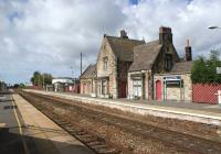 The old station building on the Wigan and Manchester bound platform at Burscough Bridge is no longer in railway use, although it still looks very much the part as it basks in the sunshine on 16 September 2010.<br> <br><br>[John McIntyre&nbsp;16/09/2010]